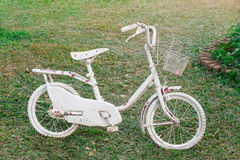 A small old white bicycles Royalty Free Stock Images