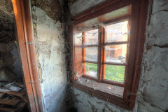 Small old window in abandoned house. Small window covered with spyder-webs in abandoned and empty house Stock Photos