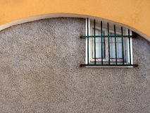 Small old window with security grille, Italy Royalty Free Stock Photography