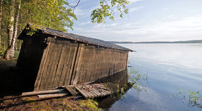 Small old wooden boat garage on the coast Stock Image