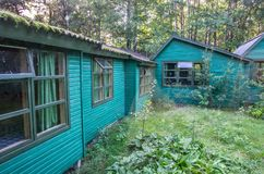Small wooden houses in forest Royalty Free Stock Photo