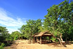 Small old wooden hut with green trees against blue sky background at Phu Phra Bat Historical Park, Udonthani, Thailand Stock Photography
