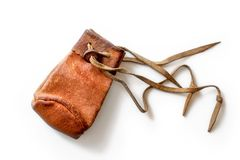 Small old worn brown leather coin pouch. Isolated on white background royalty free stock photography