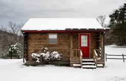 Small one roomed log cabin in snow in winter Royalty Free Stock Image
