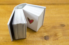 Small open book with a heart shape Royalty Free Stock Photos