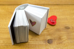 Small open book with a heart shape Stock Image