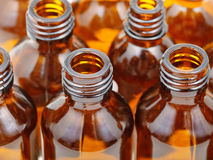 Small open brown glass pharmacy bottles close up Stock Images