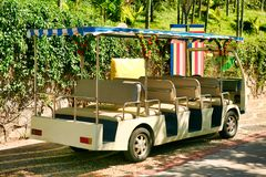A small open bus for transporting tourists in Nanshan Park. Sanya, Hainan. stock images