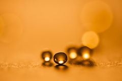 Small, orange balls abstract with bokeh Royalty Free Stock Photography