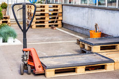 Small orange forklift parked at a warehouse Royalty Free Stock Photography