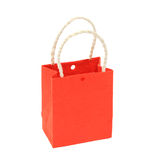 Small orange paper bag on isolated white Stock Images