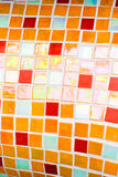 Small orange tiles texture Stock Images