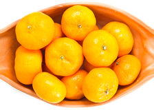 Small oranges. Small orange in bowl isolated on white background royalty free stock image