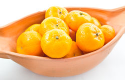 Small oranges. Small orange in bowl isolated on white background royalty free stock photo