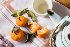Small oranges with tea pot. Royalty Free Stock Image