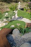 Small oriental garden for relaxing. Japanese stilb with pebble paths.  stock photos