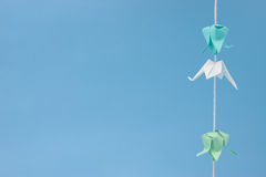 Small origami hanging on thread Stock Image
