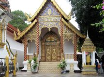 Small Ornate Buddhist temple, Thailand. This small but ornate Buddhist temple in Thailand displays decorative gold embellishment Stock Image