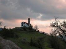 Small Orthodox Church on Mountain Peak Stock Photos