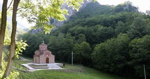 A small Orthodox church in the shadow of the forest. In the Byzantine style stock footage
