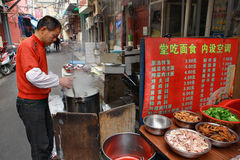 Small outdoor eatery in the open air, Shanghai, China. Royalty Free Stock Images