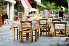 Small outdoor restaurants at the pedestrian area at center of Kalavryta town near the square and odontotos train station, Greece. Small outdoor restaurants and royalty free stock image