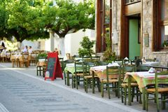 Small outdoor restaurants at the pedestrian area at center of Kalavryta town near the square and odontotos train station, Greece. Small outdoor restaurants and royalty free stock photography