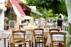 Small outdoor restaurants at the pedestrian area at center of Kalavryta town near the square and odontotos train station, Greece. Small outdoor restaurants and royalty free stock photos