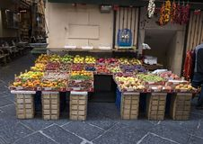 An small outdoor store with fruits and vegetables on a narrow street in Sorrento, Italy. Pictured is an outdoor store with fruits and vegetables on a narrow Royalty Free Stock Images