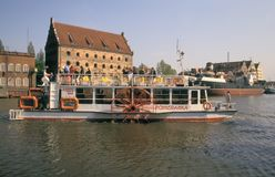 Small paddle boat with tourists in Gdansk, Poland Royalty Free Stock Image