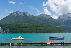 Small paddle boats on Lac d& x27;Annecy, France. Stock Photo