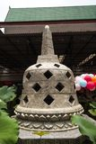A small pagoda inside Buddhist religious temple with taro leaves. Outrdoor with air balloons stock photo