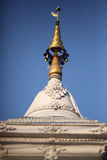 Small pagoda in the temple of Thailand. Small white pagoda in temple with blue sky background royalty free stock photo