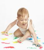 The small painter. The small child draws water paints stock images