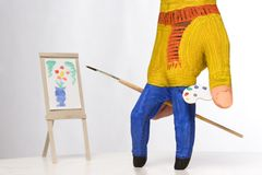Small painter painting Stock Image