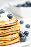 Small pancakes, closeup. Small pancakes with cream and blueberry, close up Stock Photography