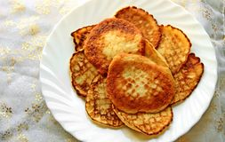 Small pancakes on a white plate. Wide pancake week Royalty Free Stock Photos