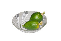 Small Papayas. Small Green Papayas on a Glass Bowl isolated on white background royalty free stock photo