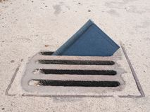 Free Small Paper Book Sticking Out From Rain Drainage Stock Photo - 154596880