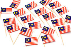 Small paper flag of Malaysia. Set of tooth pick with a small paper flag of Malaysia Royalty Free Stock Image