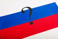 A small paper flag of Russia with a question. Mark Stock Images