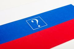 A small paper flag of Russia. With a question mark Stock Images
