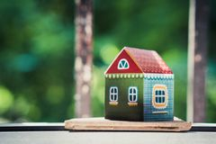 Small paper house on green nature background Stock Photo