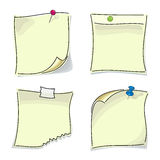 Small paper sticky notes pinned buttons. Small paper sticky notes attached to the wall with multi-colored buttons Royalty Free Stock Image