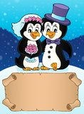 Small parchment and penguin wedding 1 stock photography