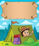Small parchment and scout in tent Stock Image
