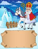 Small parchment and Sinterklaas on horse stock photo
