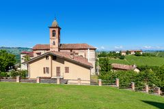 Small parish church on green lawn in Italy. Royalty Free Stock Image