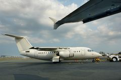 Small parked jet airliner Stock Photo