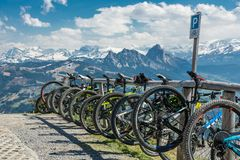 Small parking place for bicycles near Wildspitz peak in Swiss Al. WILDSPITZ, SWITZERLAND - APRIL 2017 - Small parking place for bicycles near Wildspitz peak in royalty free stock image